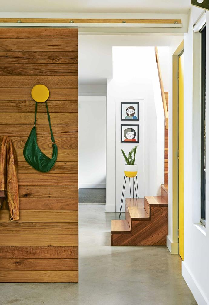 """**Say hello** In the entry, a recycled timber [sliding door](https://www.homestolove.com.au/barn-door-17386