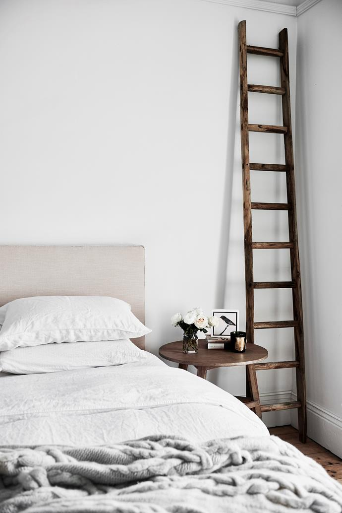 The bedhead and ladder are from Foxwood Design, the sheets are Sheridan, the throw is Country Road, the side table is from Perfect Pieces and the artwork (on table) is by Helen Wright.