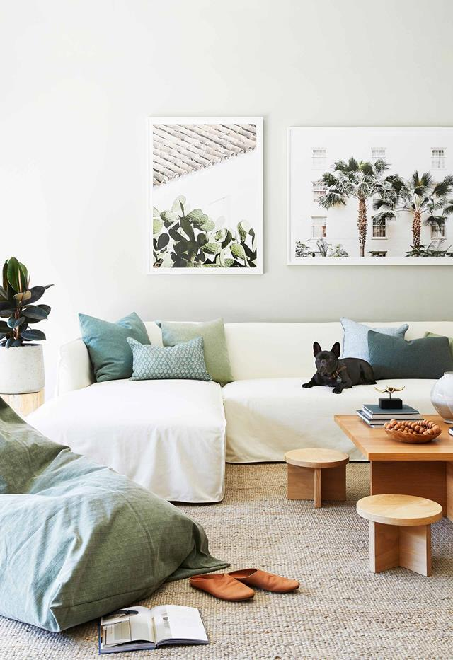 "Designed with her own extended family in mind, interior designer Melissa Bonney sees [her coastal retreat](https://www.homestolove.com.au/barefoot-bay-villa-byron-bay-21018|target=""_blank"") as the perfect space to slow down and reconnect. A pair of photographic prints from Middle Of Nowhere bring vacation vibes to the laid back living area."