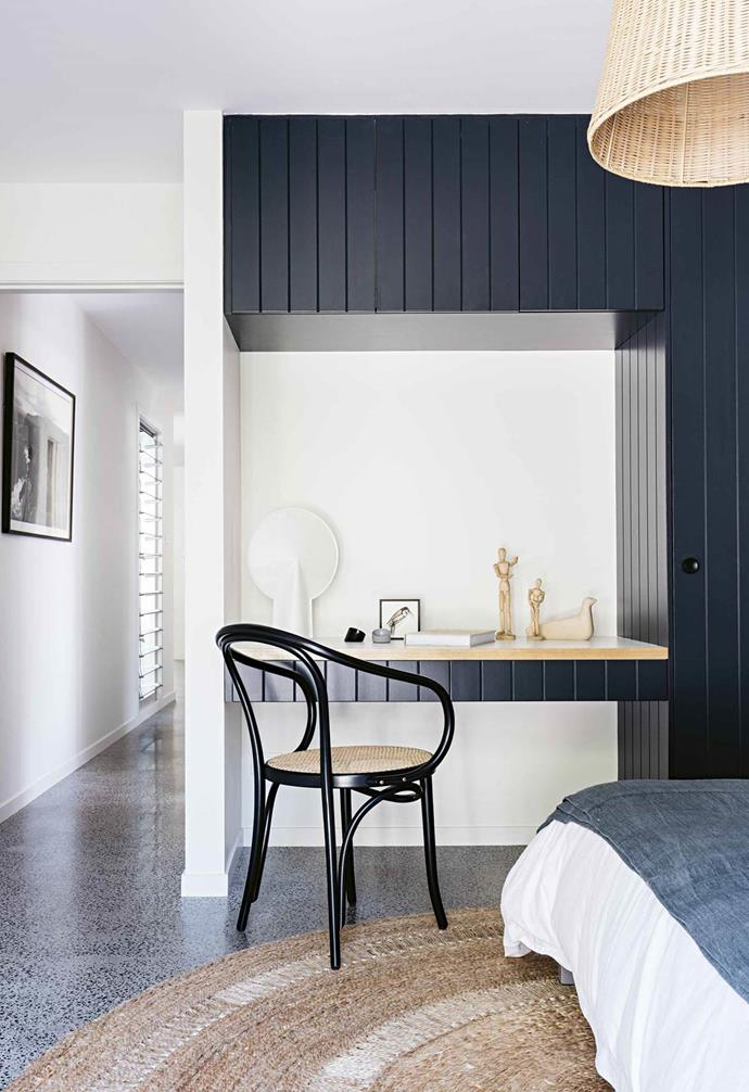 "This serene [designer beach house]((https://www.homestolove.com.au/macmasters-beach-house-18226|target=""_blank"")  takes colour cues from its bush surroundings. A desk nook in one of the bedrooms was painted in Taubmans Midnight Moss. A Hay 'Pion' lamp is a modern element while the Armadillo&Co 'Petunia' rug is a relaxed coastal chic choice."