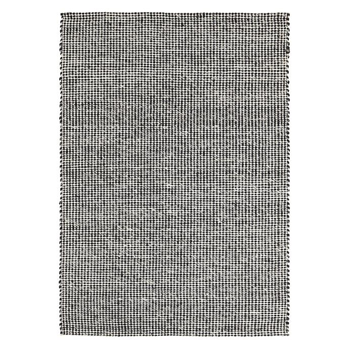 "Amalia Chunky Weave Wool rug in Black, $429, [Zanui](https://www.zanui.com.au/Amalia-Chunky-Weave-Wool-Rug-Black-124998.html|target=""_blank""|rel=""nofollow"")"
