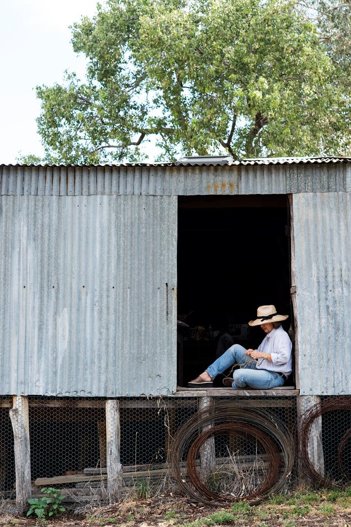 Tamara making string in the loading door of the old two-stand woolshed on her Mudgee property, Bowfield.