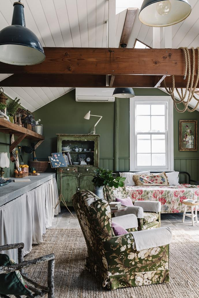 The happy mix of florals and green walls are a nod to the shed's intended use as a potting shed.