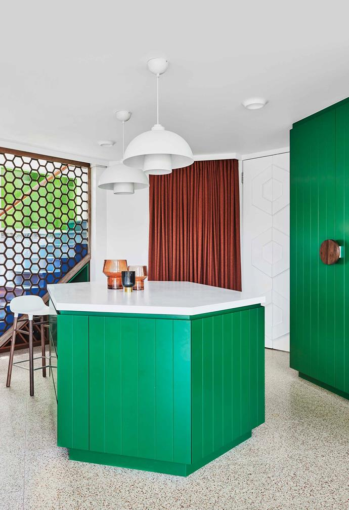 **Eating area** The vivid green is a highlight throughout the kitchen space.