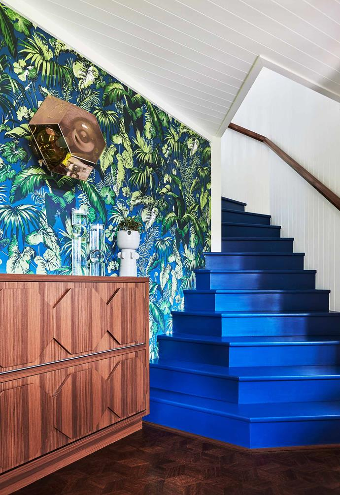 """**Staircase** Directly opposite the green front door is this Brunschwig & Fils Feuillage Blue wallpaper and Tom Dixon 'Cut Surface' wall light. Stairs painted [Dulux](https://www.dulux.com.au/