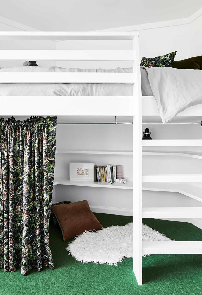 """**Bedroom** Daughter Isabelle has a custom bed built above a bookcase, which makes great use of the curved wall behind. """"There's space for a bean bag or cushions underneath, so she can hang out and read her books there,"""" says Lauren."""