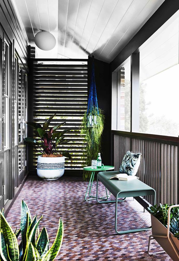 "**Verandah** Nothing says 1960s like a macramé piece. Bellevie bench, [Design Nation](https://designnation.com.au/|target=""_blank""|rel=""nofollow""). Side table, Cane-line. Floor tiles, [Teranova](http://teranova.com.au/|target=""_blank""|rel=""nofollow""). Plant hanger, [Tait](https://madebytait.com.au/|target=""_blank""|rel=""nofollow"")."