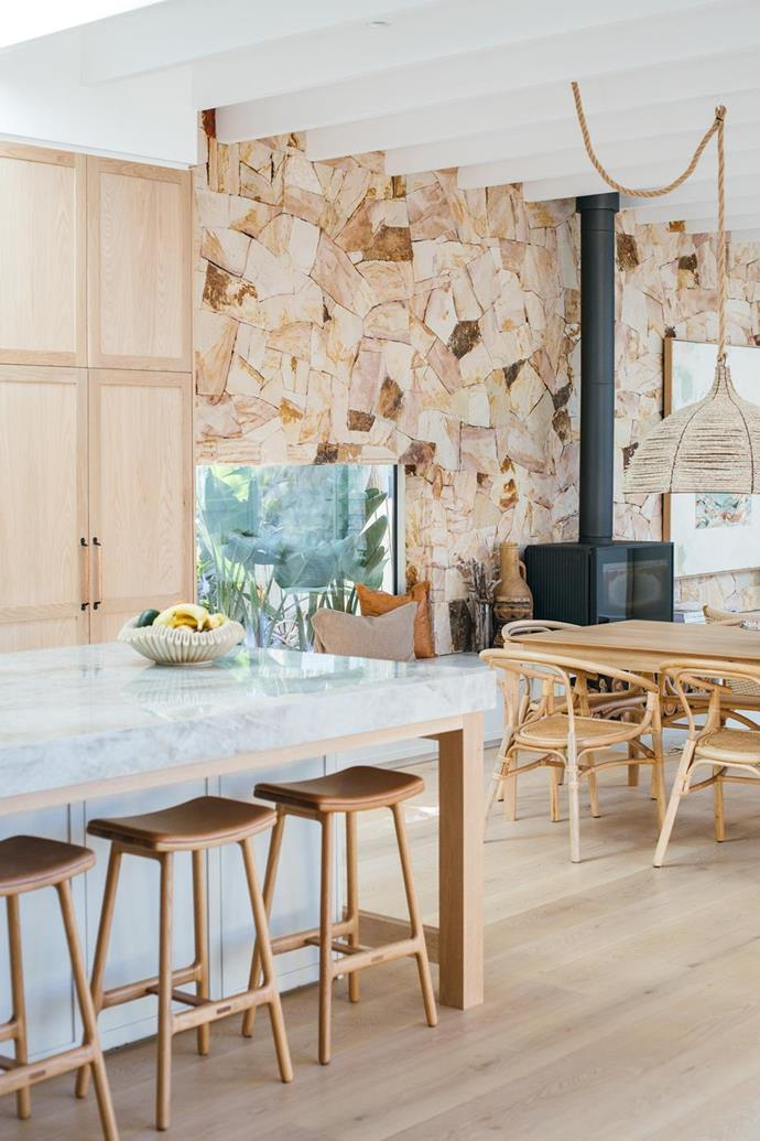 "A sandstone feature wall spans the entire length of [Kyal and Kara's sandy toned living room](https://www.homestolove.com.au/kyal-and-kara-kitchen-living-dining-21431?ref_email=cmViZWthaC5jdXJyZXJAZ21haWwuY29t&utm_source=Sailthru&utm_medium=email&utm_campaign=HTL_22052020&utm_term=list_homestolove_newsletter|target=""_blank""), creating a beautiful backdrop for the fireplace."