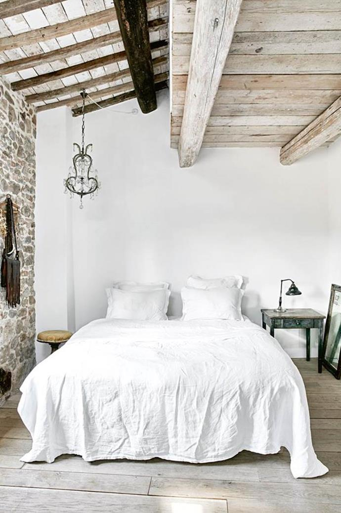 "This charming loft bedroom in a restored [17th-century Tuscan villa](https://www.homestolove.com.au/restored-tuscan-villa-12291|target=""_blank"") has retained its original stone wall along one side, in keeping with the rustic"