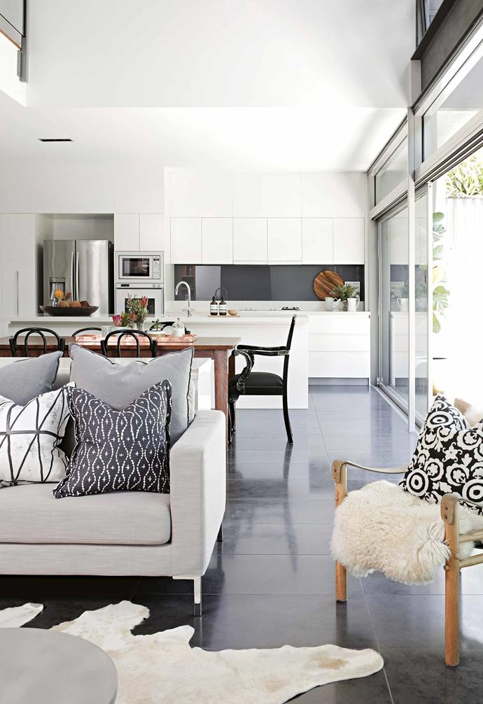 """""""Hearing what's going on and being connected with it is a simple thing, but it's important for a family, so the house is separated but open,"""" says Liam.<br><br>**Kitchen** Clean, crisp lines allow the kitchen to take a step back in the living space. The [open-plan design](https://www.homestolove.com.au/20-best-open-plan-living-designs-17877