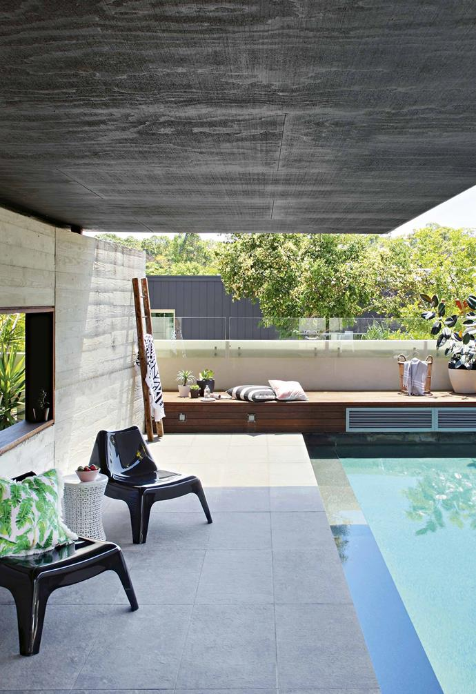 """""""I'm particularly keen on the louvres as they allow you to change the mode of light in your living space – you can hunker down and close the space off, or you can open them up and have an entirely open edge to the building,"""" says Liam.<Br><br>**Pool** In sun-kissed Noosa, the pool is a central part of living. """"We put the pool in the north-west corner, so it always gets the afternoon sun and has a strong connection to the rear living space,"""" says architect Liam Proberts. Off-white formed concrete and stained plywood cladding intersect for a beautiful contrast. """"It's a great pool for the kids. The platform at the back is like a mini diving board,"""" says Anoushka. A vintage ladder, found by her mother, makes a handy home for towels and swimming essentials."""