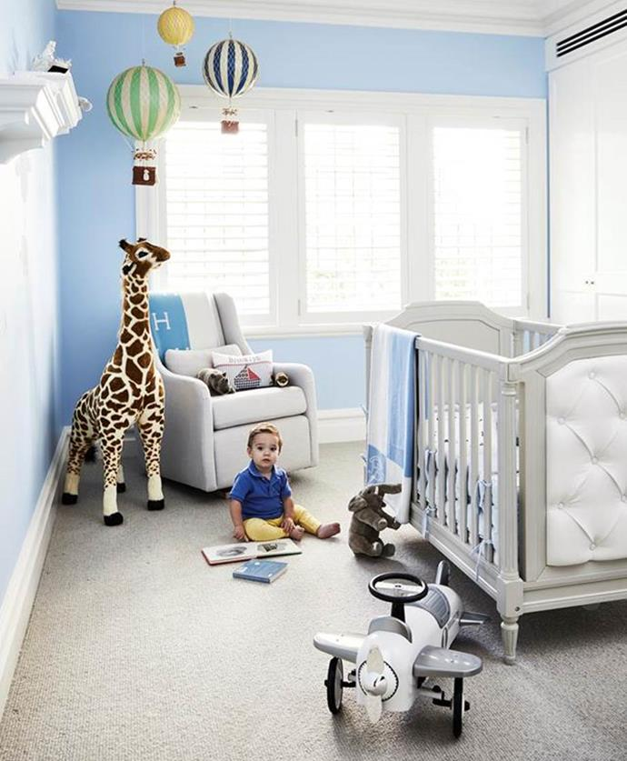 "Hot-air balloon decorations and a sizable giraffe are the charming additions to this baby boy's blue room in a [Hamptons style Art-Deco apartment](https://www.homestolove.com.au/art-deco-apartment-gets-a-hamptons-style-makeover-1-20999|target=""_blank"") in Sydney."
