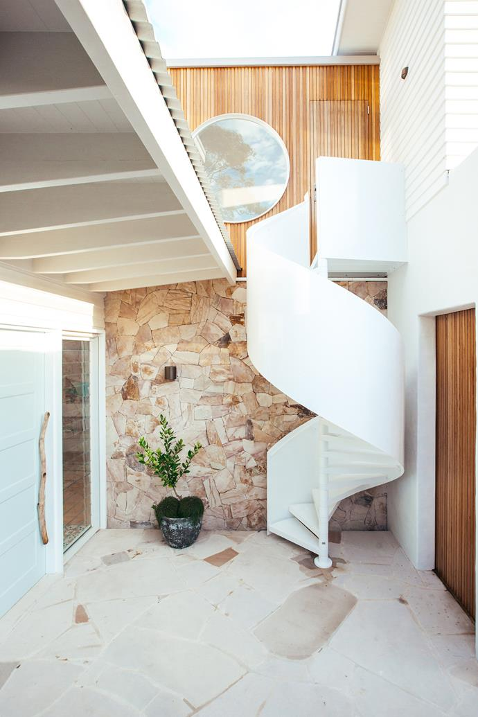 A spiral staircase provides access to the parent's retreat and home office.
