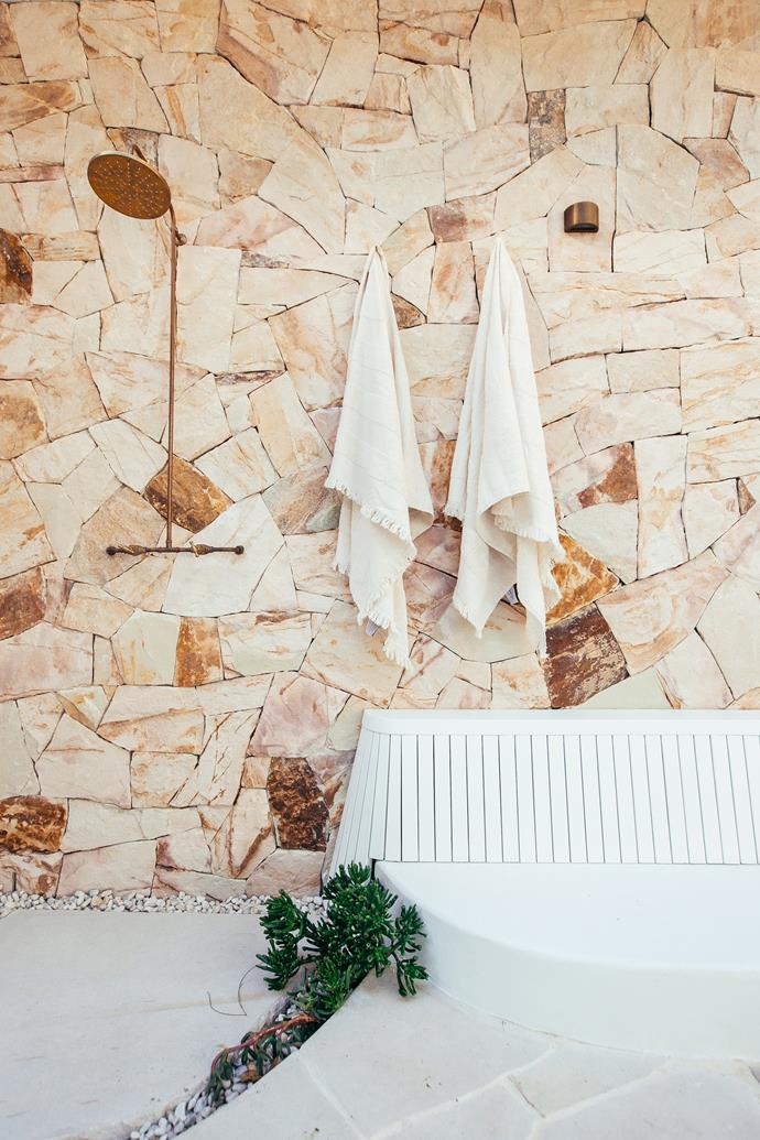 A outdoor shower is perfect for washing off the sand from the beach before jumping in the pool.