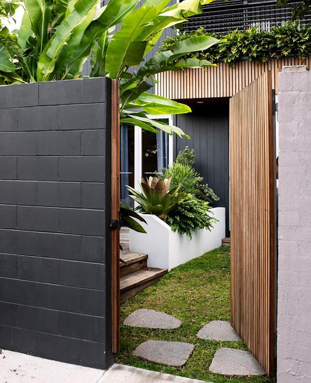 """This award-winning design transforms a petite patch into an inviting, [tropical-themed outdoor room](https://www.homestolove.com.au/small-tropical-garden-with-low-maintenance-plants-20836