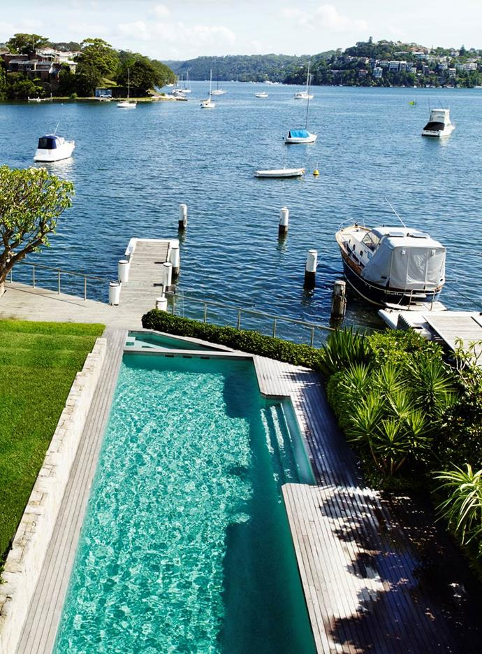 The pool in this William Dangar designed garden connects visually with the harbour beyond. Sydney home by Corben Architects.
