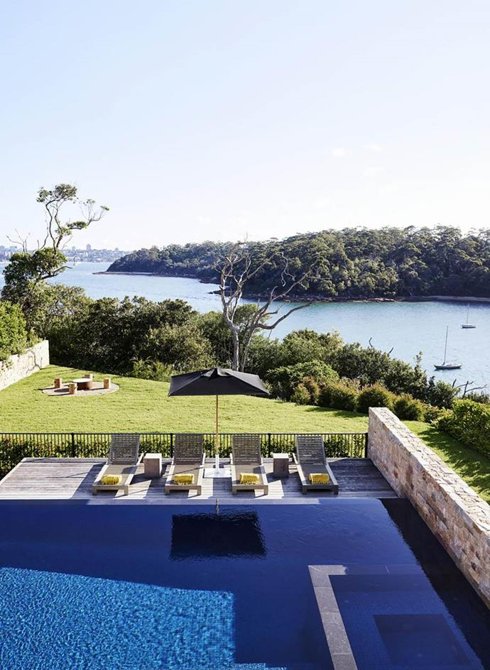 A Sydney home designed by Justine-Hugh Jones boasts expansive views to the pool and harbour beyond.