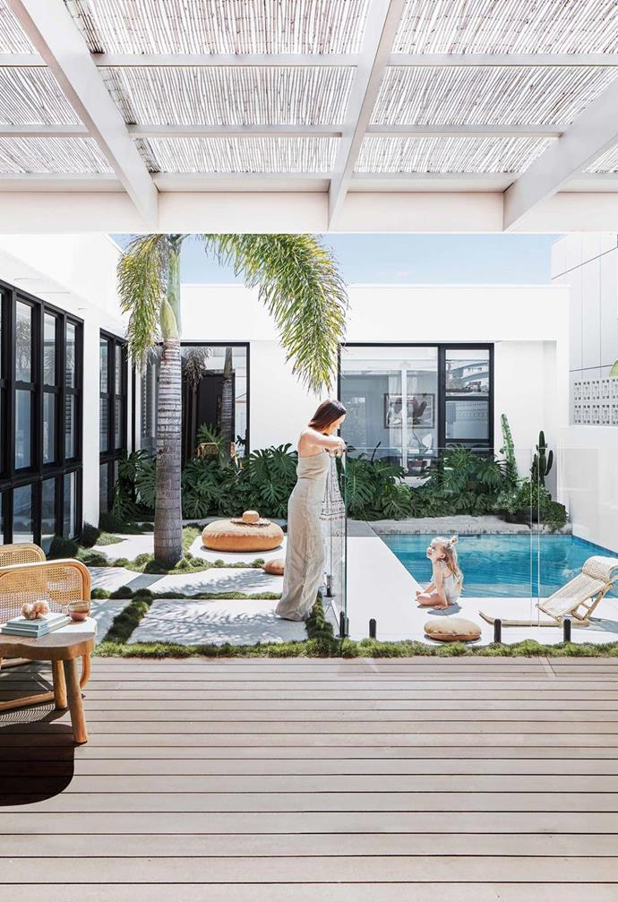 "A concrete pool is set in the middle courtyard of this [Palm Springs style home in Northern NSW](https://www.homestolove.com.au/palm-springs-inspired-home-19646|target=""_blank""). Oversized concrete stepping stones, laid alongside decking, are a practical, stylish surround."