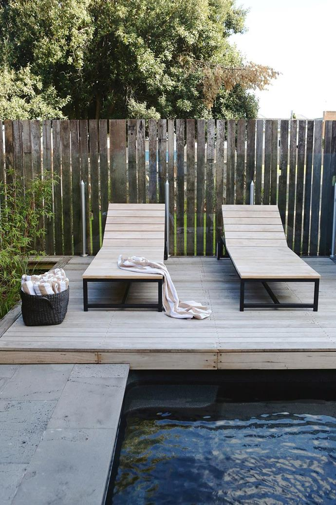 """Sun loungers are perfectly matched to the poolside decking at [Port Fairy's luxurious boutique hotel, Drift House](https://www.homestolove.com.au/port-fairy-boutique-hotel-20174