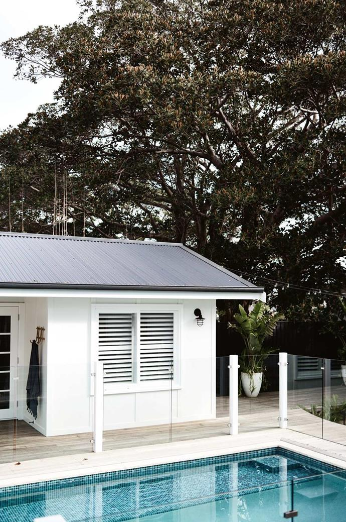 """The cabana new-build in batten and board at [SOUL of Gerringong](https://www.homestolove.com.au/coastal-farmhouse-reno-gerringong-18827 target=""""_blank"""") is wrapped with subtle decking."""
