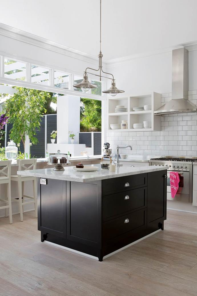 "The open-plan design of this kitchen in this [cottage renovation in Perth](https://www.homestolove.com.au/gallery-kirk-and-suzannes-perth-cottage-renovation-2323|target=""_blank"") fully embraces the outdoors with a large serving bench and window."