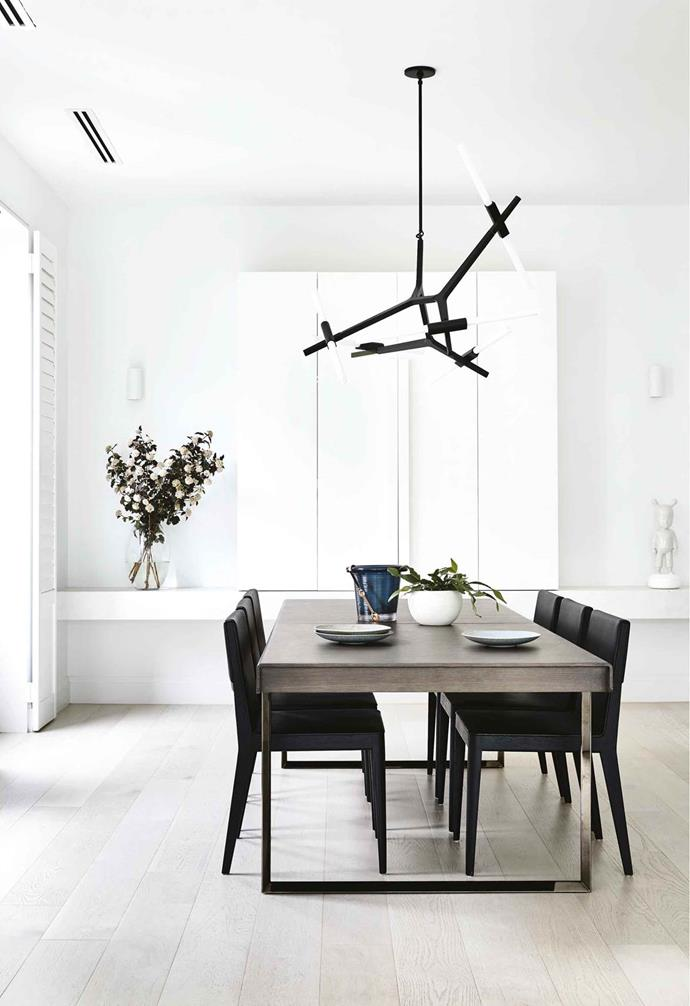 """An elegant white palette allows bold furniture and homewares to pop in this [family home](https://www.homestolove.com.au/minimalist-period-house-18410