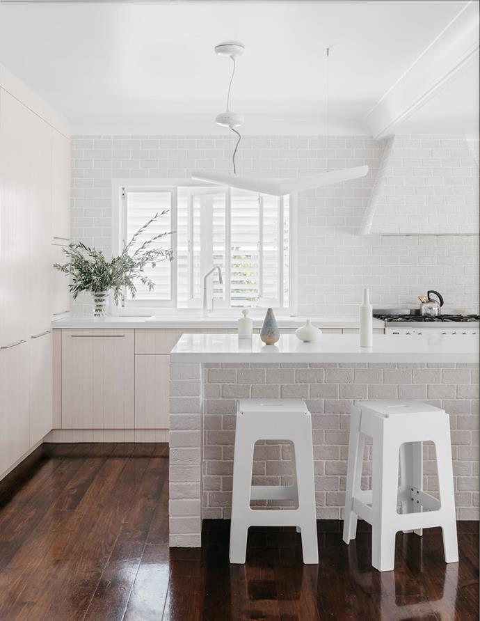 """The brick-like porcelain tiles in this [white-on-white kitchen](https://www.homestolove.com.au/all-white-kitchen-design-6370