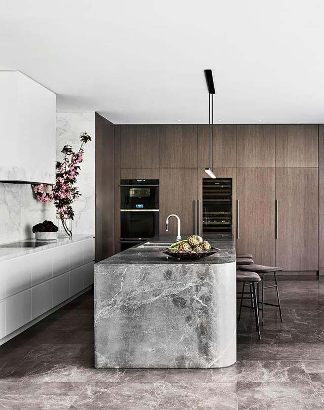 """""""It has elements of strong and rigorous bravado combined with the subtlety and softness of smooth curves,"""" explains Emma Tulloch of Emma Tulloch Architects who designed this contemporary 'forever' [family home](https://www.homestolove.com.au/spectacular-contemporary-family-home-softened-with-curves-21044