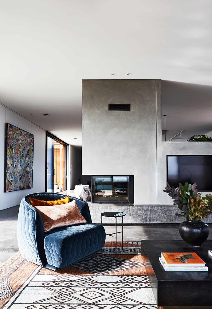 """**Sitting area/hallway** Polished concrete encases the central fireplace, by specialist concreter Keenan Harris. Moroso 'Redondo' armchair, [Hub](http://www.hubfurniture.com.au/
