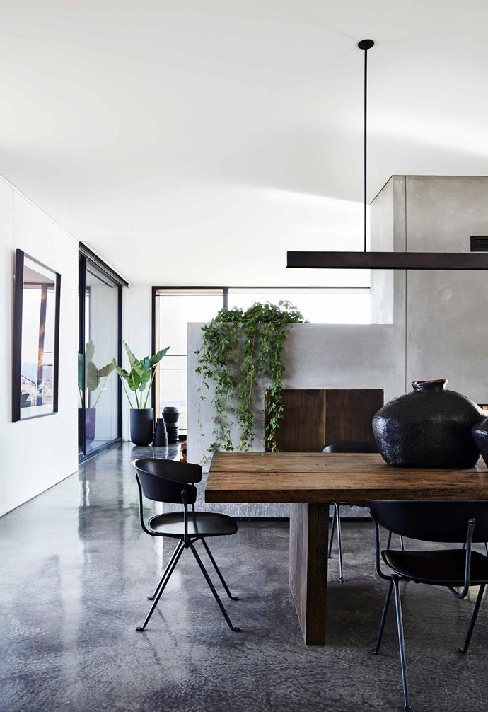 """**Dining space**The custom table was made by Lost Arc Antiques and matched with Magis 'Officina' leather chairs from [Dedece](https://dedece.com/
