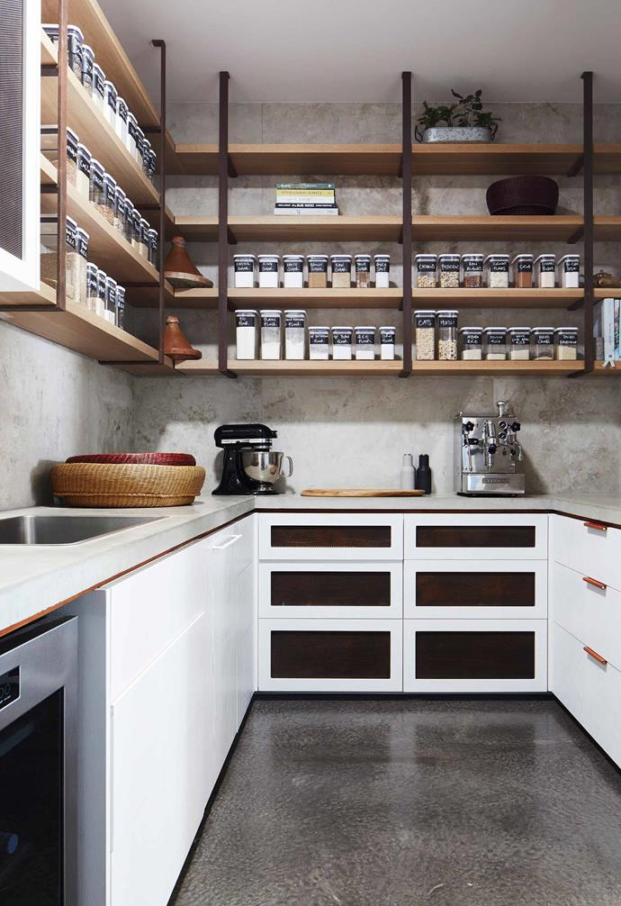 """**Pantry** As the home is a fair distance from town, Dot has to be organised and always have essential ingredients to hand, as seen in the pantry's impressive line-up of glass storage containers. The stone on the bench is Tundra Blue, supplied by [Apex Stone](https://www.apexstone.com.au/