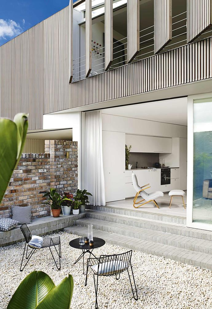 "Pebbles and pot plants are great easy-to-maintain options for a courtyard. Sliding doors connect the indoor and outdoor areas in the courtyard of this [multigenerational home in Balmain](https://www.homestolove.com.au/multigenerational-living-home-17001|target=""_blank""), making it feel like one big space."