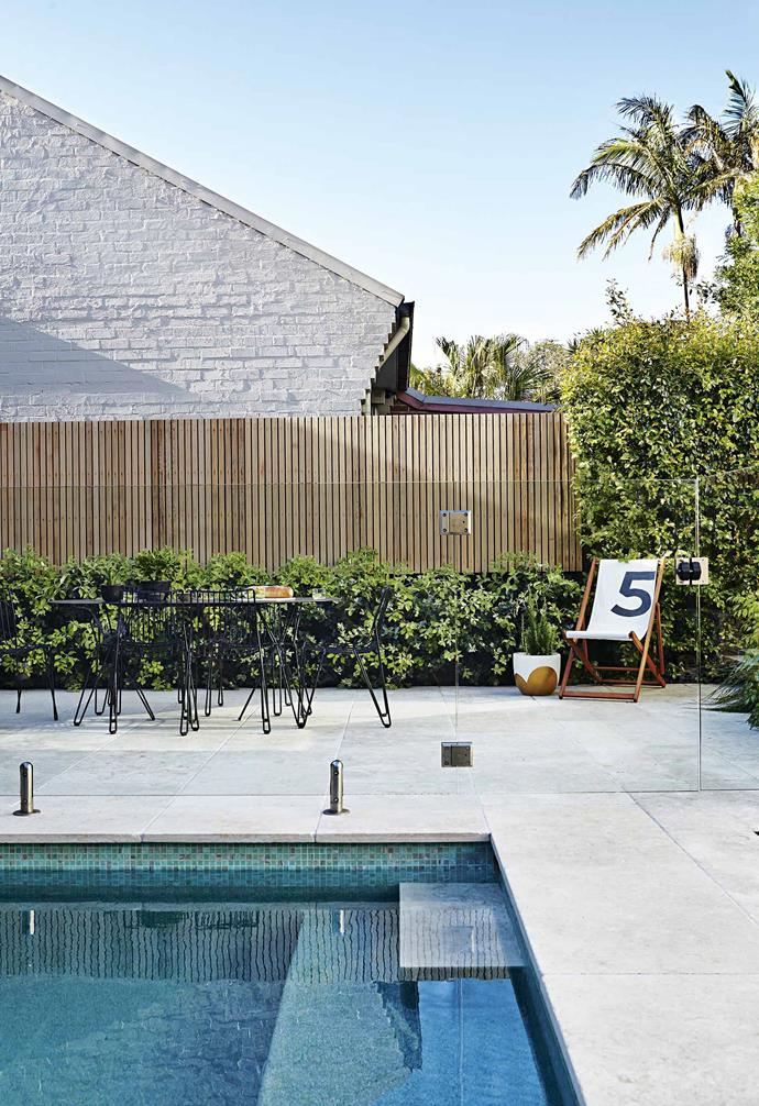 """The owners' desire for a smooth [transition between indoors and outdoors](https://www.homestolove.com.au/12-indooroutdoor-ideas-for-a-stunning-entertaining-area-18680