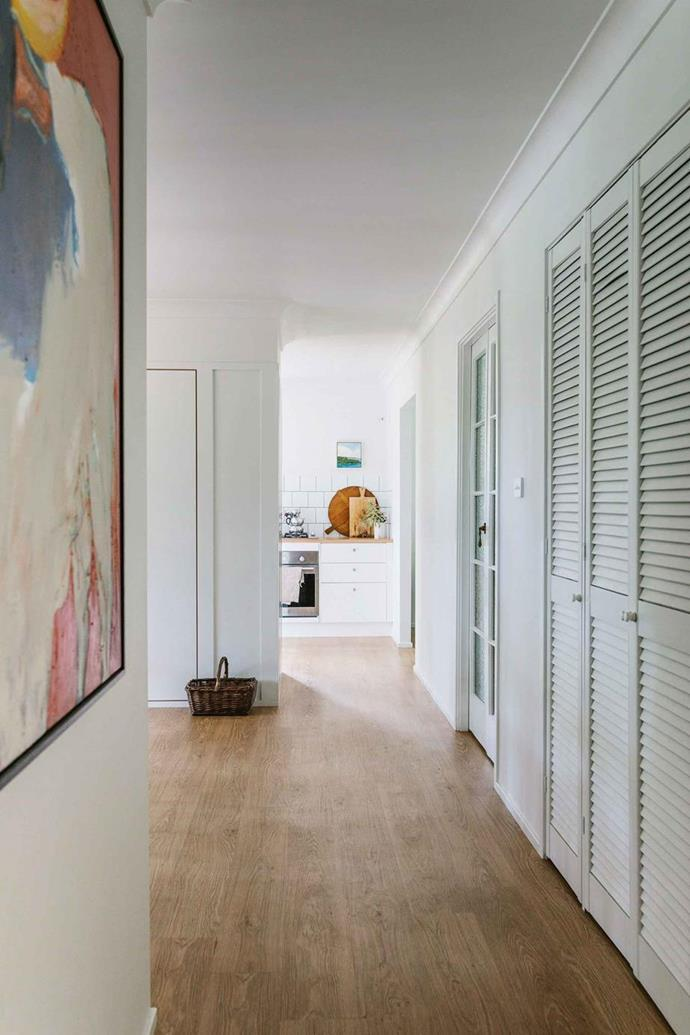 "This hallway has been revamped with vinyl laminate plank flooring in a [DIY Byron Bay home renovation](https://www.homestolove.com.au/diy-home-renovation-12290|target=""_blank""). Photo: Marnie Hawson 