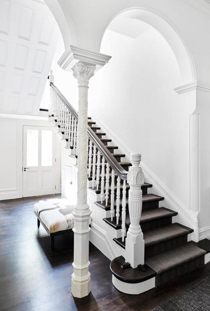 """A sensitive update to this [handsome heritage house](https://www.homestolove.com.au/heritage-home-sydney-receives-sensitive-update-20172 target=""""_blank"""") by Susanne Gorman has made it fresh and relevant for a family of six with a statement staircase setting the stage. The balustrade was painted white to help lighten the interior."""