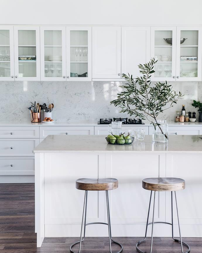 "The generous kitchen of this [family farmhouse in NSW](https://www.homestolove.com.au/white-relaxed-family-farmhouse-nsw-18947|target=""_blank"") features a mix of glass-fronted cabinet doors and shaker style cabinetry to create a dynamic look in the all-white space."