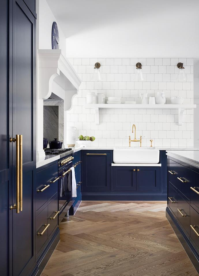 In the renovation of this 1910's Mornington Peninsula home the owners' love of navy and white came to the forefront. Bold navy shaker style kitchen cabinets are paired with a striking white tiled splashback and benchtops. Brass tapware and door pulls tie the look together.