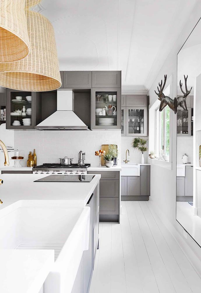 "Opting for a crisp white palette in [his country home, interiors expert Neale Whittaker](https://www.homestolove.com.au/neale-whitakers-country-kitchen-renovation-19789|target=""_blank"") added dark grey shaker style kitchen cabinets to the kitchen to help ground the modern country look."