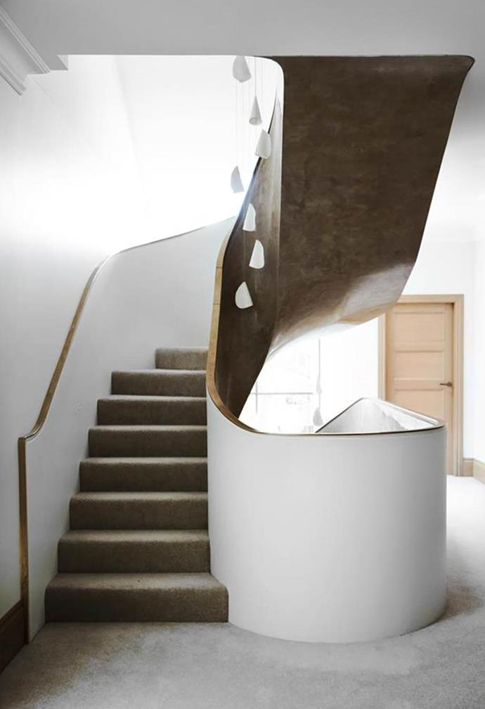 """The original elegant arches within [this heritage home](https://www.homestolove.com.au/heritage-property-fashioned-into-elegant-house-20094