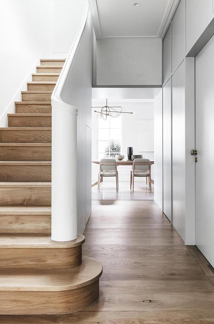 """By shifting the entrance to the side of the structure and consolidating two poky staircases into a central light well the architects who redesigned this [Victorian-era home in Sydney](https://www.homestolove.com.au/contemporary-update-for-a-sydney-heritage-home-19571