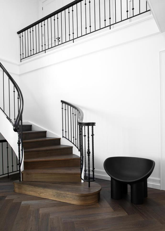 """A [French-influenced family home with a neutral palette](https://www.homestolove.com.au/french-influenced-home-with-neutral-palette-21407 target=""""_blank"""") hold this classic staircase with steel rails and Argento herringbone flooring from Precision Flooring."""