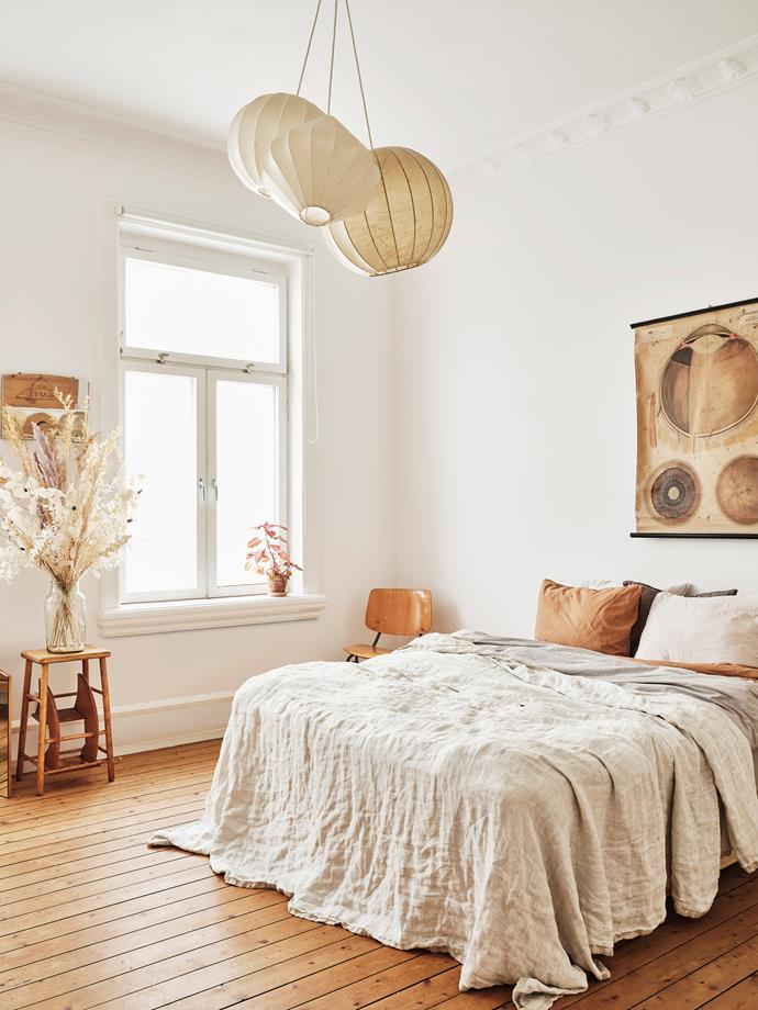 """I love wood,"" Sophie says of the timber decor throughout her home. In the bedroom, the wood is softened with textiles and a pillowy 1960s [pendant](https://www.homestolove.com.au/14-pendant-lights-that-pack-a-punch-2989