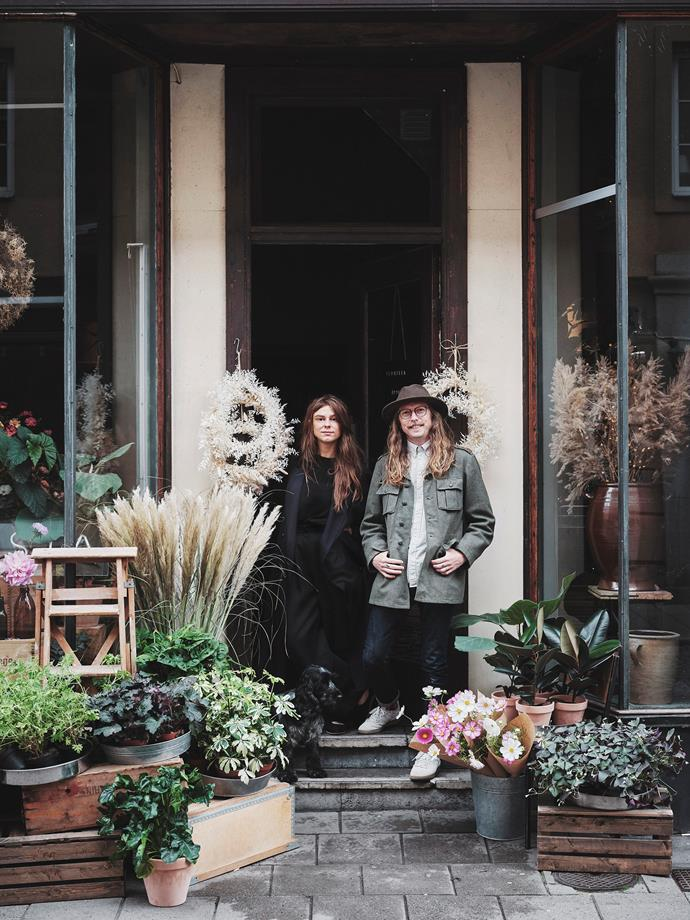 "Sophie Wiking pictured standing out the front of Sophie's shop Florista, with her husband Gustaf, which is fortuitously nestled between two antique stores. ""It's easy to pick up something on my way home,"" Sophie says."