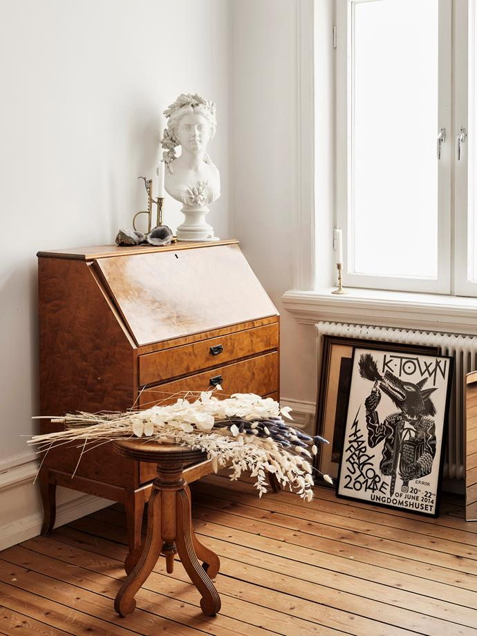 "Every piece of furniture and [lighting](https://www.homestolove.com.au/lighting-tips-for-every-room-in-the-house-1550|target=""_blank"") in the bedroom, including this cabinet, is a secondhand find that Sophie has given new life to."