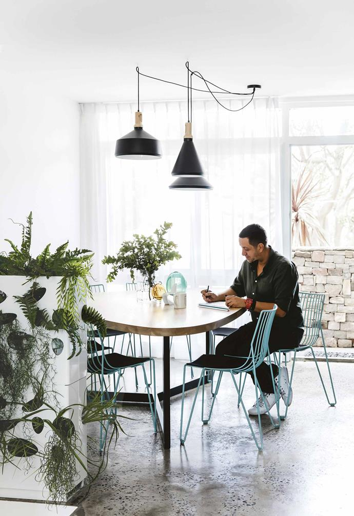 """Upon buying the home in 2002, Petrit's design eye instantly saw its huge potential. However, not all went to plan when it came to purchasing the home. """"I invited my best mate to come and view the place,"""" says Petrit.<br><br>**Dining area** Open chairs from [Spence & Lyda](https://www.spenceandlyda.com.au/