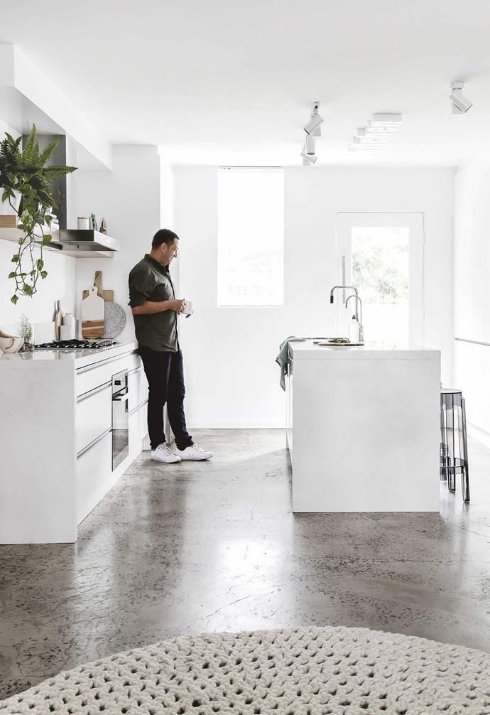 """Putting his design skills and knowledge into practice, the ideas began to flow. """"I began to sketch and create my own design brief,"""" says Petrit. """"Being the client and designer in your own home, you can let your imagination run wild.""""<br><br>**Kitchen** Petrit reconfigured the floorplan to allow for a more open feel. The door leads out to the [courtyard](https://www.homestolove.com.au/courtyard-patio-ideas-9294