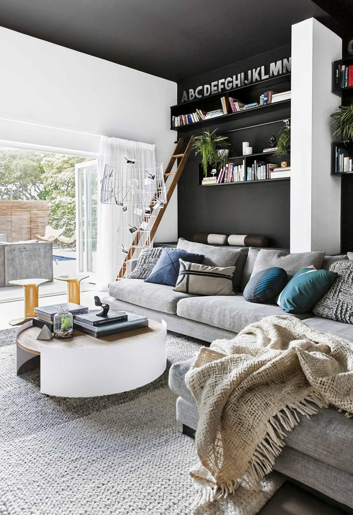 """The renovation was undertaken in two stages, with the first step gutting all the internal rooms and reconfiguring the floorplan, before construction started. Petrit had the genius idea of converting the redundant double garage downstairs (with a 3.8-metre ceiling height!) into an oversized library living room, thus creating a much larger split-level home. Another clever use of space was combining the bathroom and WC into one large bathroom, creating room for a [freestanding bath](https://www.homestolove.com.au/freestanding-bath-design-ideas-4520