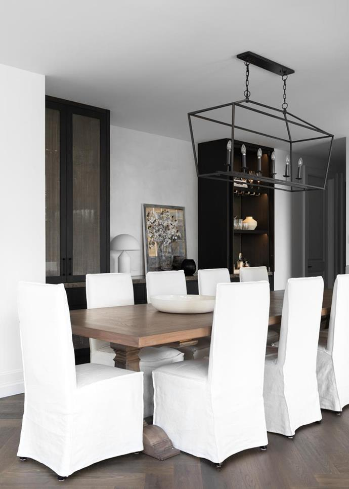 "A classic lantern-style pendant light from The General Trading Company adorns the dining room of this [French-influenced family home](https://www.homestolove.com.au/french-influenced-home-with-neutral-palette-21407|target=""_blank"") with a neutral palette."