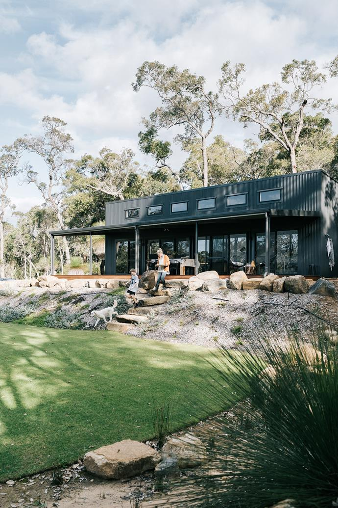 Tanya Cain-Abbs, her son Ollie, 12, and labradoodle Maisy love their home among the gum trees, in Yallingup, Western Australia. Tanya and her husband Duncan opted for a simple shed-style home, clad in Colorbond Monument so it nestles into the bush.