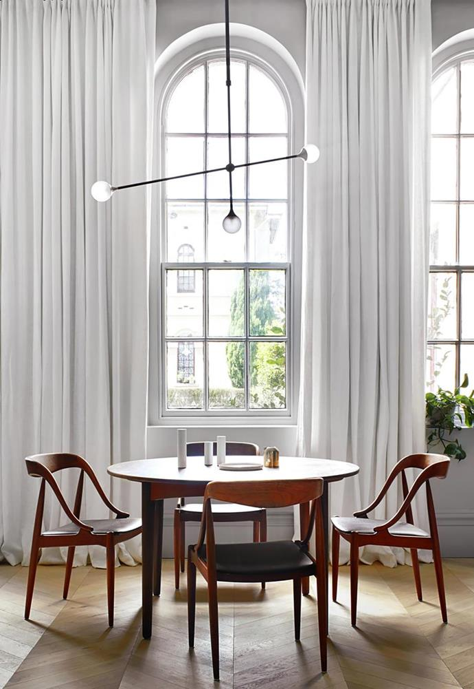 "Even small dining rooms don't have to compromise on style. This [small flat designed by Sarah Wolfendale](https://www.homestolove.com.au/small-flat-revamp-19729|target=""_blank"") is made elegant by a 'Bullarum SI-3 Chandelier' by Krisztian Mecs from Intueri Light."